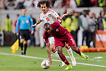 Abdelkarim Hassan of Qatar (front) fights for the ball with Mohamed Abdulrahman Alraqi of United Arab Emirates (back) during the AFC Asian Cup UAE 2019 Semi Finals match between Qatar (QAT) and United Arab Emirates (UAE) at Mohammed Bin Zaied Stadium  on 29 January 2019 in Abu Dhabi, United Arab Emirates. Photo by Marcio Rodrigo Machado / Power Sport Images