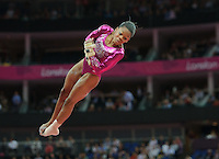 London, England - Thursday, August 2, 2012: USA's Gabrielle Douglas competes in the vault and wins gold in the women's gymnastics individual all around at the London 2012 Summer, Olympic Games, North Greenwich Arena, London. .