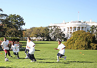 """Kids play a game in front of the White House during a  D.C United clinic in support of first lady Michelle Obama's """"Let's Move"""" initiative on the White House lawn, in Washington D.C. on October 7 2010."""