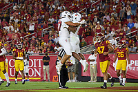 LOS ANGELES, CA - SEPTEMBER 11: Bradley Archer #87 and Nathaniel Peat #8 of the Stanford Cardinal celebrate after an 87 yard touchdown run by Nathaniel Peat during a game between University of Southern California and Stanford Football at Los Angeles Memorial Coliseum on September 11, 2021 in Los Angeles, California.