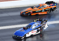 Oct 29, 2016; Las Vegas, NV, USA; NHRA funny car driver Gary Densham (near) loses traction and goes sideways alongside Anthony Begley during qualifying for the Toyota Nationals at The Strip at Las Vegas Motor Speedway. Mandatory Credit: Mark J. Rebilas-USA TODAY Sports