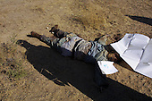 Kabul, Afghanistan<br /> November 21, 2001<br /> <br /> Taliban fighters and foreign soldiers killed during the fight for Kabul against the Northern Alliance are collected from the front lines.