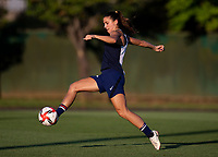KASHIMA, JAPAN - AUGUST 1: Alex Morgan #13 of the USWNT takes a shot during a training session at the practice field on August 1, 2021 in Kashima, Japan.