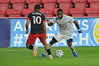 WASHINGTON, DC - NOVEMBER 8: Zachary Brault-Guillard #15 of Montreal Impact battles for the ball with Edison Flores #10 of D.C. United during a game between Montreal Impact and D.C. United at Audi Field on November 8, 2020 in Washington, DC.