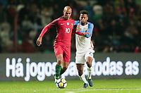 Leiria, Portugal - Tuesday November 14, 2017: João Mário, Kellyn Acosta during an International friendly match between the United States (USA) and Portugal (POR) at Estádio Dr. Magalhães Pessoa.
