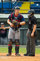 Elizabethton Twins catcher Stuart Turner (31) chats with home plate umpire Randy Rosenberg between batters during the Appalachian League game against the Burlington Royals at Burlington Athletic Park on August 11, 2013 in Burlington, North Carolina.  The Twins defeated the Royals 12-5.  (Brian Westerholt/Four Seam Images)