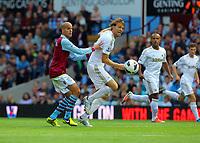 Saturday 15 September 2012<br /> Pictured: Michu of Swansea (R) challenged by Karim El Ahmadi of Aston Villa (L).<br /> Re: Barclay's Premier League, Aston Villa v Swansea City FC at Villa Park, West Midlands, UK.