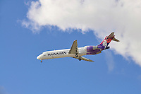 A Hawaiian Airlines plane, wheels down, about to land at the Honolulu International Airport, Honolulu, O'ahu.