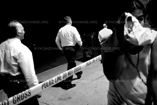 Chicago, Illinois, USA<br /> May 2007<br /> <br /> Chicago police officers investigate the scene of a police shooting in the Chicago's Humboldt Park neighborhood a gang member pulled a gun on an off-duty Chicago Police officer and was shot near the crime since about five teenagers are shot daily in the Chicago's metropolitan area.