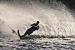 Waterskier throws a huge wall of water.