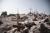 Some pilgrims uses to place a cross on top of the Mt. Krizevac to consecrate their passed loved ones to the Virgin Mary.<br /> Medjugorje, Bosnia and Herzegovina. July 2012