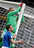 Soccer Football - 2018 World Cup Qualifications - Europe - Italy vs Sweden - San Siro, Milan, Italy - November 13, 2017 <br /> Sweden's goalkeeper Robin Olsen (up) in action with Italy's Andrea Belotti (down) during the FIFA World Cup 2018 qualification football match between Italy and Sweden at the San Siro Stadium in Milan on November 13, 2017.<br /> UPDATE IMAGES PRESS/Isabella Bonotto
