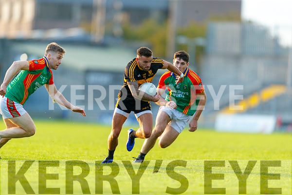 Micheál Burns, Dr. Crokes in action against Peter Crowley, Mid Kerry and Mike Breen, Mid Kerry during the Kerry County Senior Football Championship Semi-Final match between Mid Kerry and Dr Crokes at Austin Stack Park in Tralee, Kerry.