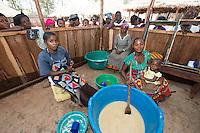 Africa, DRC, Democratic Republic of the Congo, South Kivu, Kamanyola. Women for Women project. WFW Kamanyola co-op and lifeskills training. Women making medicinal soap to sell. Kiza Mugala, stirring the mixture.