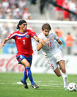 Ebi Smolarek (15) of Poland leans into Cristian Bolanos (7) of Costa Rica. Poland defeated Costa Rica 2-1 in their FIFA World Cup Group A match at FIFA World Cup Stadium, Hanover, Germany, June 20, 2006.
