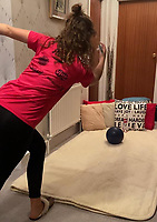 BNPS.co.uk (01202 558833)<br /> Pic: VerityCrawley/BNPS<br /> <br /> Pictured: Verity Crawley practicing in the hallway. <br /> <br /> Britain's only professional ten-pin bowler has won her first ever title after the pandemic forced her to train in her parents' hallway.<br /> <br /> Verity Crawley had to return to the UK after her American athlete's visa was unexpectedly denied in January this year.<br /> <br /> The 26-year-old resorted to padding her parents' 10ft long hallway with pillows and cushions so she could train every day as bowling alleys were shut during lockdown.