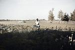 Belarussian women in her garden, Krichev, Belarus.<br /> Une jeune femme biélorusse dans son jardin à la campagne, Krichev, Biélorussie.