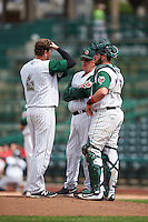 Fort Wayne TinCaps pitching coach Burt Hooton (32) talks with relief pitcher Will Headean (6) and catcher Austin Allen (23) during the second game of a doubleheader against the Great Lakes Loons on May 11, 2016 at Parkview Field in Fort Wayne, Indiana.  Great Lakes defeated Fort Wayne 5-0.  (Mike Janes/Four Seam Images)