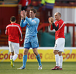 Hamilton goalkeeper Michael McGovern and manager Alex Neil on the park as they applaud their support at full-time