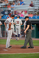 Connecticut Tigers manager Gerald Laird (12) argues a call with umpire Evin Johnson during a game against the Auburn Doubledays on August 10, 2017 at Falcon Park in Auburn, New York.  Connecticut defeated Auburn 4-1.  (Mike Janes/Four Seam Images)