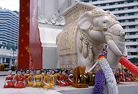 This statue is part of a shrine to the Hindu god Trimurti who is believed to be the divine creator of planet earth. It is located at a major intersection in central Bangkok. Worshipers stream through at all hours offering prayers and leaving gifts of flow