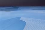 Sunset on gypsum sand dunes, New Mexico.
