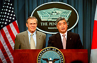 Dec. 10, 2001, Washington, DC, United States<br /> <br /> Secretary of Defense Donald H. Rumsfeld (left) listens as the Director General of the Japan Defense Agency Gen Nakatani responds to a reporter's question at a Pentagon joint press availability on Dec. 10, 2001.  The two leaders met earlier to discuss issues of mutual interest to both countries