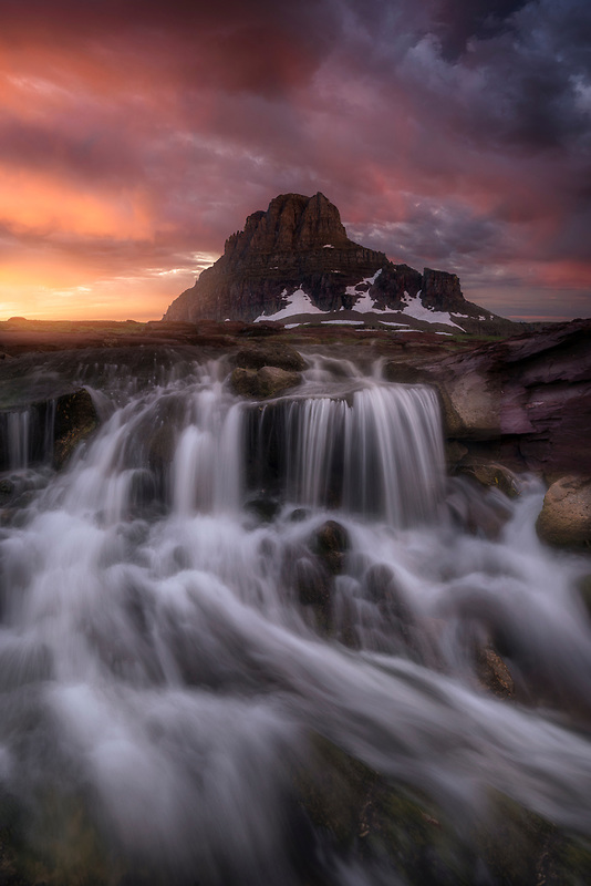 Sunrise eruption and waterfall. Glacier National Park, MT.