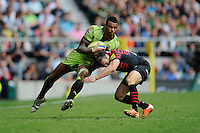Courtney Lawes of Northampton Saints barges through the tackle of Chris Wyles of Saracens during the Aviva Premiership Final between Saracens and Northampton Saints at Twickenham Stadium on Saturday 31st May 2014 (Photo by Rob Munro)