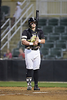 Evan Skoug (11) of the Kannapolis Intimidators closes his eyes and takes a deep breath before stepping into the batters box during the game against the Hagerstown Suns at Kannapolis Intimidators Stadium on May 4, 2018 in Kannapolis, North Carolina.  The Intimidators defeated the Suns 11-0.  (Brian Westerholt/Four Seam Images)