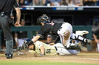 Vanderbilt Commodores outfielder JJ Bleday (51) slides head first into the plate during the ninth inning of Game 12 of the NCAA College World Series as Louisville Cardinals catcher Henry Davis (32) attempts to block him on June 21, 2019 at TD Ameritrade Park in Omaha, Nebraska. Bleday scored the winning run as Vanderbilt defeated Louisville 3-2. (Andrew Woolley/Four Seam Images)