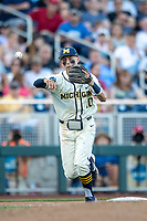 Michigan Wolverines third baseman Blake Nelson (10) makes a throw to first base against the Vanderbilt Commodores during Game 1 of the NCAA College World Series Finals on June 24, 2019 at TD Ameritrade Park in Omaha, Nebraska. Michigan defeated Vanderbilt 7-4. (Andrew Woolley/Four Seam Images)