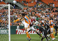 Troy Perkins #23 of D.C. United watches Brian Ching #25 of the Houston Dynamo head over the bar during an MLS match at RFK Stadium in Washington D.C. on September  25 2010. Houston won 3-1.
