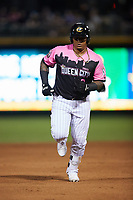 Yermin Mercedes (24) of the Charlotte Knights rounds the bases after hitting a home run during the game against the Gwinnett Stripers at Truist Field on July 17, 2021 in Charlotte, North Carolina. (Brian Westerholt/Four Seam Images)