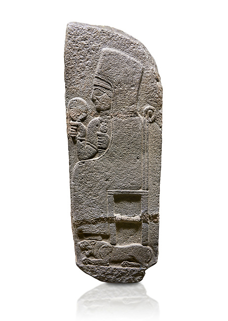 Hittite monumental relief sculpted orthostat stone panel of a Procession Basalt, Karkamıs, (Kargamıs), Carchemish (Karkemish), 900 - 700 B.C. Anatolian Civilisations Museum, Ankara, Turkey.<br /> <br /> Goddess Kubaba. End of pannels. The godess is saeted on a chair which is on a lion. she hold a mirror in her right hand and a pomegranate in her left.<br /> <br /> Against a white background.