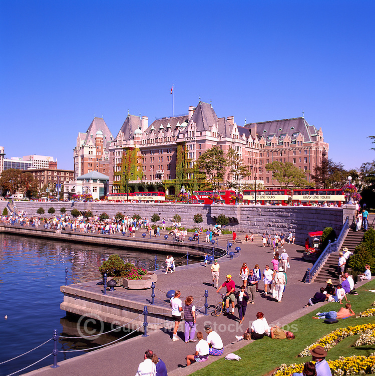 Victoria, BC, Vancouver Island, British Columbia, Canada - Tourists walking along The Lower Causeway and Inner Harbour, past the Fairmont Empress Hotel