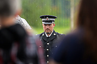 Pictured: A representative of South Wales Police attends the burial at Thornhill Cemetery, Cardiff, Wales, UK. Tuesday 28 June 2016<br /> Re: The funeral of Sion, the baby boy found dead in the River Taff in Cardiff has taken place<br /> Generous locals raised nearly £1,400 for the memorial after reading about plans to hold a fitting ceremony for the newborn baby whose body was discovered in Cardiff a year ago.<br /> The funeral took place at the Briwnant Chapel at Thornhill Crematorium, Cardiff. Members of the public are invited to be among the congregation.