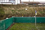 A sign warning people to keep off the steep grass banking. The Look Local Stadium is built on the side of a valley. Stocksbridge Park Steels v Pickering Town, Evo-Stik East Division, 17th November 2018. Stocksbridge Park Steels were born from the works team of the local British Steel plant that dominates the town north of Sheffield.<br /> Having missed out on promotion via the play offs in the previous season, Stocksbridge were hovering above the relegation zone in Northern Premier League Division One East, as they lost 0-2 to Pickering Town. Stocksbridge finished the season in 13th place.