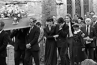 Pix: Copyright Anglia Press Agency/Archived via SWpix.com. The Bamber Killings. August 1985. Murders of Neville and June Bamber, daughter Sheila Caffell and her twin boys. Jeremy Bamber convicted of killings serving life...copyright photograph>>Anglia Press Agency>>07811 267 706>>..Jeremy Bamber is comforted by his girlfriend Julie Mugford at the funeral of his family, alongside Colin Caffell, father and husband of victims. no date..ref 0006 neg 13...
