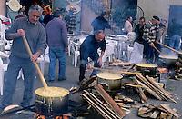 Large group of men preparing polenta, Belvedere village, French Alps, France.