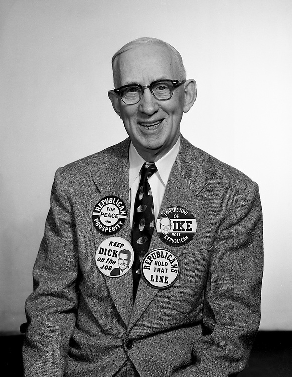 Client: A.G. Trimble Company<br /> Ad Agency: none<br /> Contact: Mr. Arthur Trimble<br /> Product: Promotional Buttons<br /> Location: Brady Stewart Studio, 725 Liberty Avenue Pittsburgh<br /> <br /> Mr. A. G. Trimble modeling his Political buttons.  The AG Trimble company was an Advertising Specialties company located in the Jenkins Arcade building on Liberty Ave in downtown Pittsburgh.  The Jenkins Arcade was the first indoor mall in the United States.