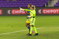 ORLANDO, FL - JANUARY 22: Sandra Sepúlveda #12 speaks to teammate Daniela Montoya #6 during a game between Colombia and USWNT at Exploria stadium on January 22, 2021 in Orlando, Florida.