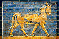 Aurochs relief pictures on glazed bricks from the Ishtar Gate, Babylon, Iraq constructed in about 575BC by order of King Nebuchadnezzar II on the north side of the city. Dedicated to the Babylonian goddess Ishtar, the monumental gate joined the inner & outer walls of Babylon it was one of the Seven Wonders of the ancient world. Istanbul Archaeological Museum.