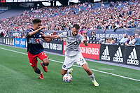 FOXBOROUGH, MA - JULY 25: Rudy Camacho #4 of CF Montreal battles with Brandon Bye #15 of New England Revolution for the ball near the New England Revolution goal during a game between CF Montreal and New England Revolution at Gillette Stadium on July 25, 2021 in Foxborough, Massachusetts.
