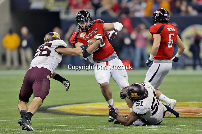 Texas Tech Red Raiders tight end Jace Amaro (22) in action during the Meineke Car Care Bowl game of Texas between the Texas Tech Red Raiders and the Minnesota Golden Gophers at the Reliant Stadium in Houston, Texas. Texas defeats Minnesota 34 to 31.