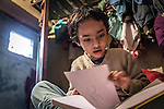 ***SEXUAL ASSAULT VICTIM - COURT PROCEEDINGS IN INDIA HAVE BANNED IDENTIFYING THE VICTIM***<br /> 8 November 2013, Govindpuri, Delhi , INDIA: Six year old Daisy sits on the bed of the tiny one bedroom home she shares with her two siblings and parents in Govindpuri, Delhi. Daisy has been the victim of a sexual assault and it has been devastating for her and her family. Many girls face a variety of hurdles to receiving an education in India that range from ease of access to schools, traditional beliefs in the community, sexual abuse and poverty. Picture by Graham Crouch/ Good Weekend