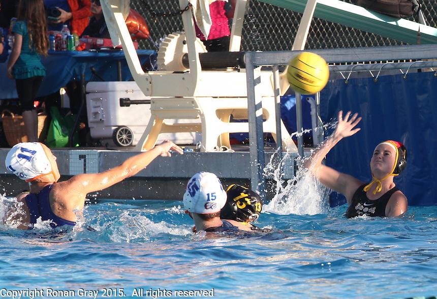 San Diego CA, USA.  Wednesday, 4th February 2015:  Mission Bay High School Lady Bucs Water Polo team play Clairemont High School at the Clairemont Recreation Center.
