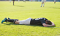 Dundee's Craig Beattie collapses face down as he celebrates after scoring their third goal.