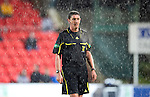 St Johnstone v Celtic..27.10.10  .A wet ref Craig Thomson.Picture by Graeme Hart..Copyright Perthshire Picture Agency.Tel: 01738 623350  Mobile: 07990 594431