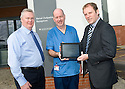 ::  SERCO :: RENAL UNIT WIFI LAUNCH :: SERCO CONTRACT DIRECTOR MIKE MACKAY (RIGHT) AND IT MANAGER GORDON REID (LEFT) PRESENT THE NEW IPAD TO SENIOR STAFF NURSE KEN WEIR TO OFFICIALLY LAUNCH THE NEW RENAL UNIT WIFI SERVICE FOR PATIENTS  ::